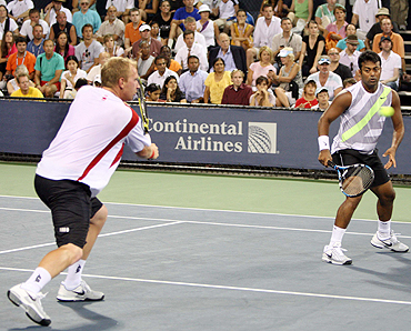 India's Leander Paes (right) and Czech Lukas Dlouhy during their opening round match on Tuesday