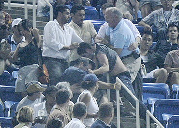 A fight breaks out in the stands during the match between Novak Djokovic and Philipp Petzschner