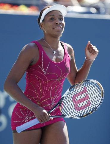 Venus Williams of the U.S. celebrates her victory against Shahar Peer of Israel