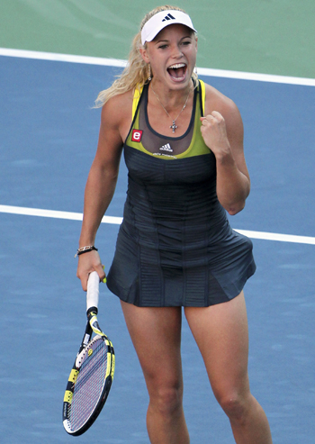 Caroline Wozniacki of Denmark celebrates her victory against Maria Sharapova of Russia at the U.S. Open