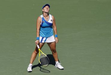 Svetlana Kuznetsova of Russia reacts to a poor shot against Dominika Cibulkova of Slovakia
