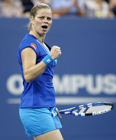 Kim Clijsters of Belgium celebrates winning the first set against Samantha Stosur of Australia