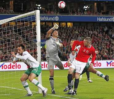 Portugal's goalkeeper Eduardo tries to save a ball during their Euro 2012 qualifying match against Norway