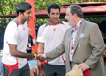 Pakistan's ambassador to the UN, Abdullah Haroon (right) greets Indian tennis player Rohan Bopanna as Pakistan player Aisam Qureshi looks on, in New York on Thursday