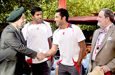 India's ambassador to the UN, Hardeep Puri (left) greets Aisam Qureshi, as Bopanna and Abdullah Haroon look on, in New York on Thursday