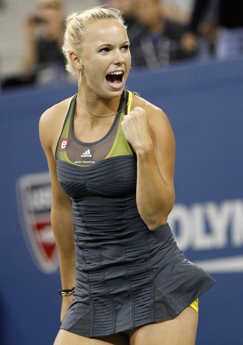 Caroline Wozniacki of Denmark celebrates defeating Dominika Cibulkova of Slovakia
