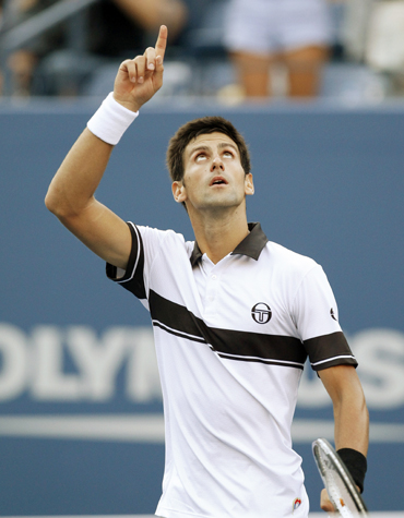Novak Djokovic of Serbia celebrates his victory against Gael Monfils of France