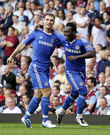 Chelsea's Michael Essien (right) celebrates with Branislav Ivanovic after scoring against West Ham United on Saturday