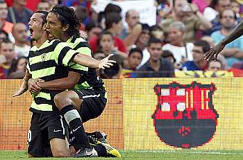Hercules's player Nelson Valdez and Abel Aguilar celebrate a goal against Barcelona