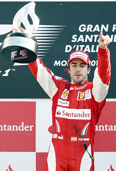 Fernando Alonso celebrates after winning the It