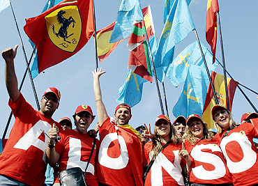 Fans of Fernando Alonso cheer during the Italian GP in Monza