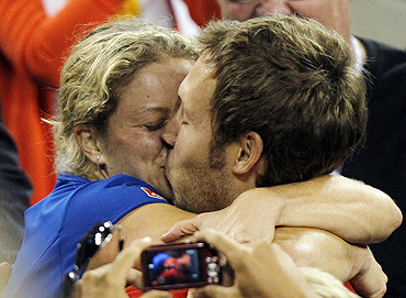 Kim Clijsters  kisses her husband Brian Lynch after winning the US Open final