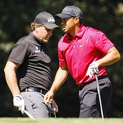 Phil Mickelson (left) with Tiger Woods