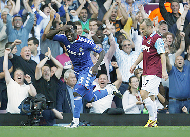 Chelsea's Michael Essien celebrates after scoring