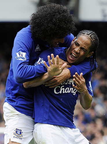 Everton's Steven Pienaar (right) celebrates with a teammate after scoring
