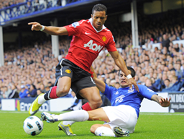 Everton's Tim Cahill (right) and Manchester United's Nani vie for possession