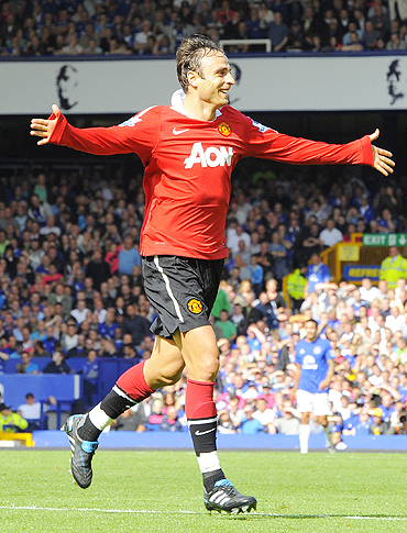Dimitar Berbatov celebrates after scoring against Everton