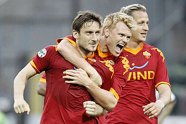 AS Roma's Francesco Totti (left), John Arne Riise and Philippe Mexes (right)