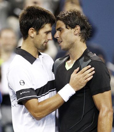 Rafael Nadal of Spain (R) hugs Novak Djokovic of Serbia after Nadal won