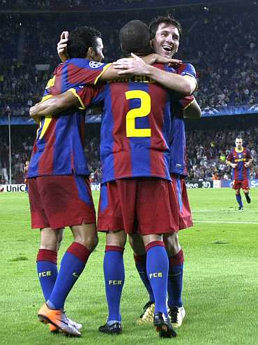 Barcelona players celebrate after scoring a goal
