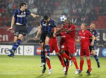 Diego Milito scores an own goal against Twente