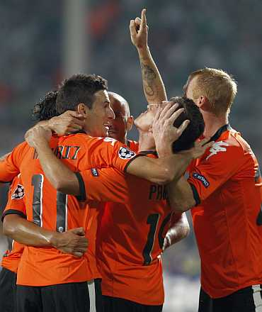 Valencia's players celebrate after their goal against Bursaspor