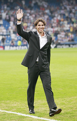 Rafa Nadal waves to the crowd at the Bernebeu stadium on Wednesday