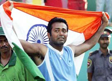 Paes draped in the tricolour