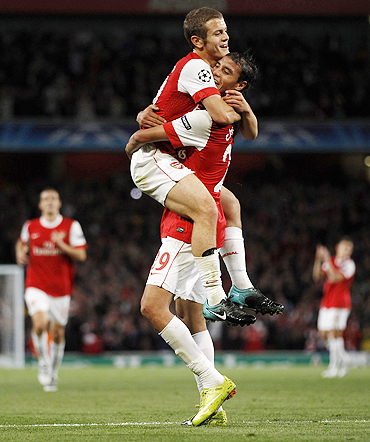 Arsenal's Marouane Chamakh (right) celebrates with Jack Wilshire after scoring against Braga