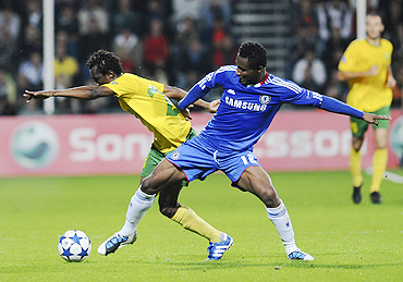 Zilina's Babatounde Bello (left) and Chelsea's John Obi Mikel vie for possession during their match on Wednesday