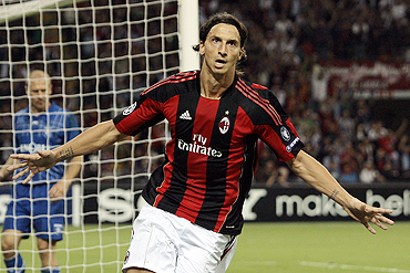 AC Milan's Zlatan Ibrahimovic celebrates after scoring against Auxerre