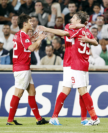Spartak Moscow's Dmitri Kombarov (right) celebrates with teammates after scoring against Olympique Marseille