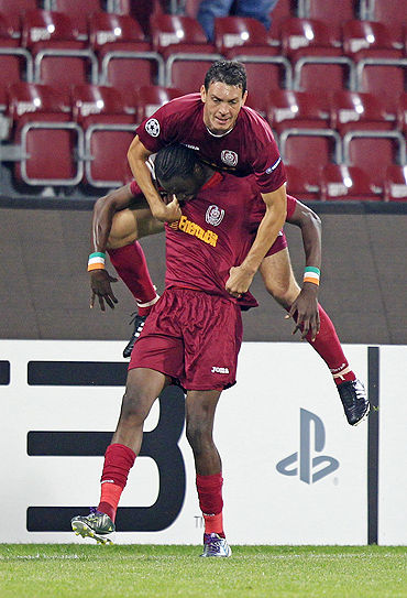 CFR Cluj's Ionut Rada (top) congratulates teammate Lacina Traore after scoring against FC Basel