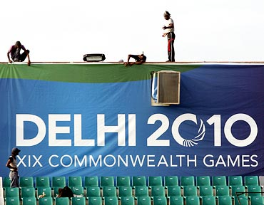 Labourers work inside the Major Dhyan Chand National Stadium, one of the venues for the 2010 Commonwealth Games in Delhi