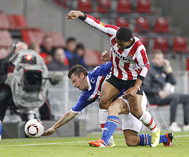 PSV Eindhoven's Jeremain Lens (right) and Sampdoria's Antonio Cassano vie for possession during their Group I Europa League match