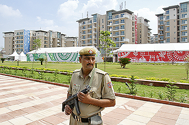 A policeman stands guard at the Commonwealth Games village in New Delhi
