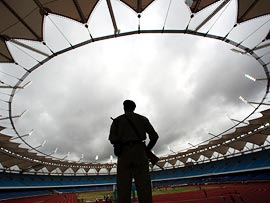 A security guard mans a stadium to be used for the Commonwealth Games in New Delhi