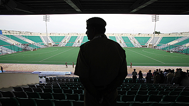 A policeman inside the Major Dhyan Chand National Stadium