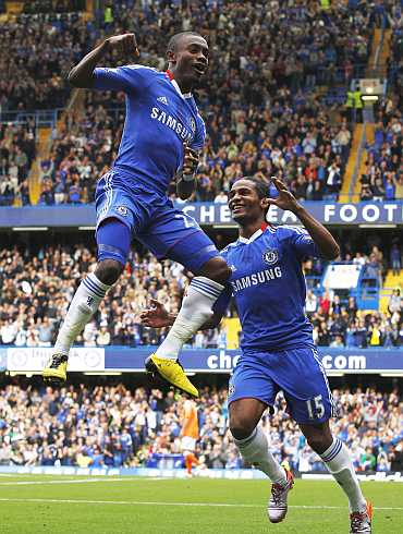 Salomon Kalou and Florent Malouda celebrate after scoring against Blackpool