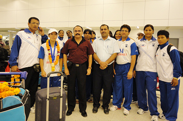 MC Mary Kom with teammates and officials
