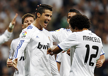 Cristiano Ronaldo (left) celebrates with teammates after scoring against Espanyol