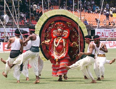 Dancers from Kerala perform at a cricket match