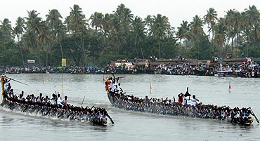 Oarsmen row their boat at the Nehru boat race in Alleppy district