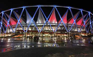 an illuminated Jawaharlal Nehru Stadium