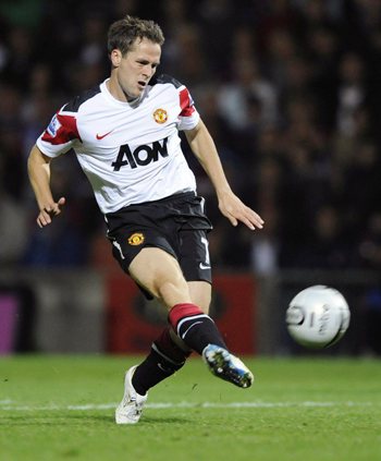 Manchester United's Michael Owen shoots to score against Scunthorpe United during their English League Cup soccer match in Scunthorpe