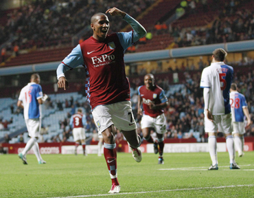 Aston Villa's Ashley Young celebrates his first goal against Blackburn Rovers during their English League Cup