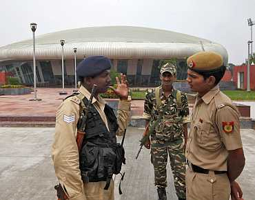 Indian security personal outside the weightlifting venue for the upcoming Commonwealth Games in New Delhi