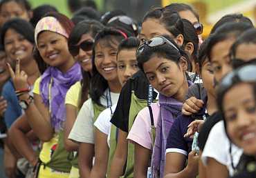 Volunteers queue at the Nehru Stadium