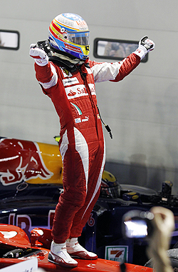 Fernando Alonso celebrates after winning the Singapore GP on Sunday