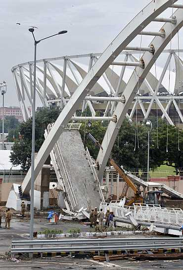 The collapsed pedestrian bridge outside the Jawaharlal Nehru Stadium.